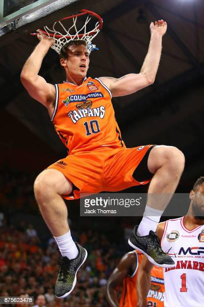 Mitch McCarron of the Cairns Taipans dunks during the round seven NBL match between Cairns and Illawarra at Cairns Convention Centre on November 18...