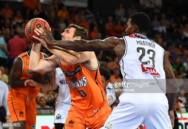 Mitch McCarron of the Taipans is fouled by Casey Prather of Melbourne United during the round nine NBL match between the Cairns Taipans and Melbourne...