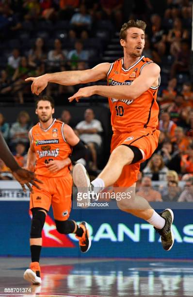 Mitch McCarron of the Taipans passes the ball during the round nine NBL match between the Cairns Taipans and Melbourne United at Cairns Convention...
