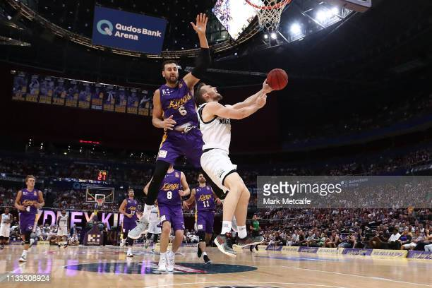 Mitch McCarron of United is challenghed by Andrew Bogut of the Kings during game two of the NBL Semi Final series between the Sydney Kings and...