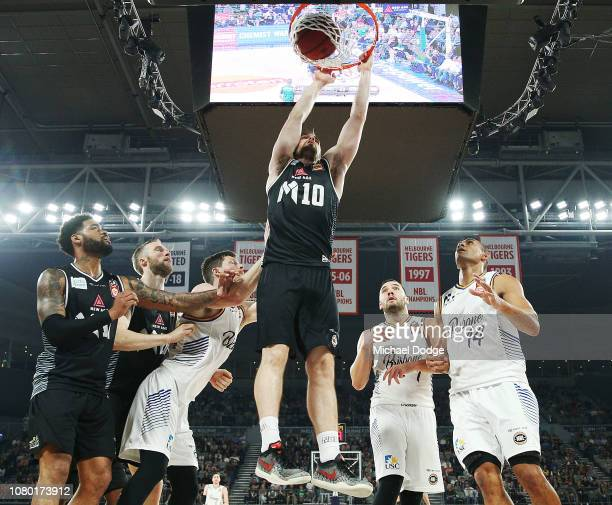Mitch McCarron of United slam dunks during the round eight NBL match between Melbourne United and the Brisbane Bullets at Hisense Arena on December...