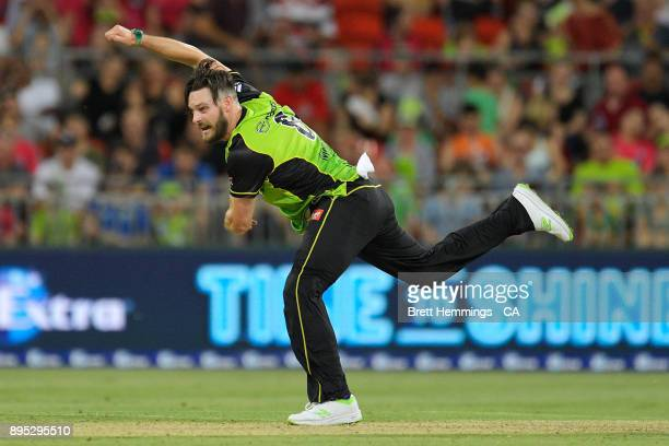 Mitch McClenaghan of the Thunder bowls during the Big Bash League match between the Sydney Thunder and the Sydney Sixers at Spotless Stadium on...