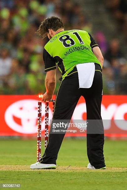 Mitch McClenaghan of the Thunder runs out Jake Lehmann of the Strikers during the Big Bash League match between the Sydney Thunder and the Adelaide...