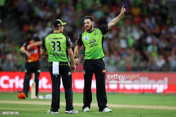 Mitch McClenaghan of the Thunder talks to team mate Shane Watson during the Big Bash League match between the Sydney Thunder and the Perth Scorchers...