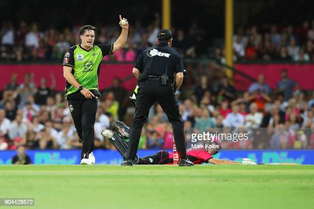 Mitch McClenaghan of the Thunder unsuccessfully appeals for the wicket of Daniel Hughes of the Sixers during the Big Bash League match between the...