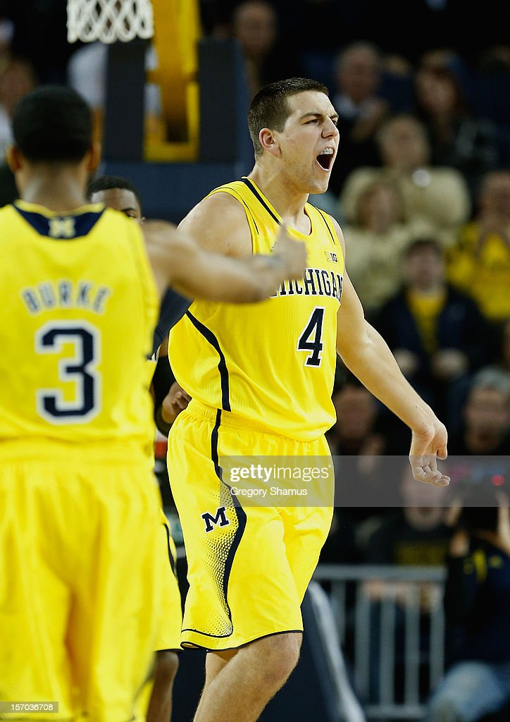 Mitch McGary #4 of the Michigan Wolverines reacts after a first half play while playing the North Carolina State Wolfpack at Crisler Center on November 27, 2012 in Ann Arbor, Michigan. Michigan won the game 79-72.