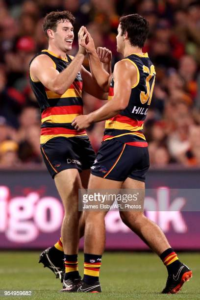 Mitch McGovern and Darcy Fogarty of the Crows celebrate a goal during the 2018 AFL round seven match between the Adelaide Crows and the Carlton Blues...