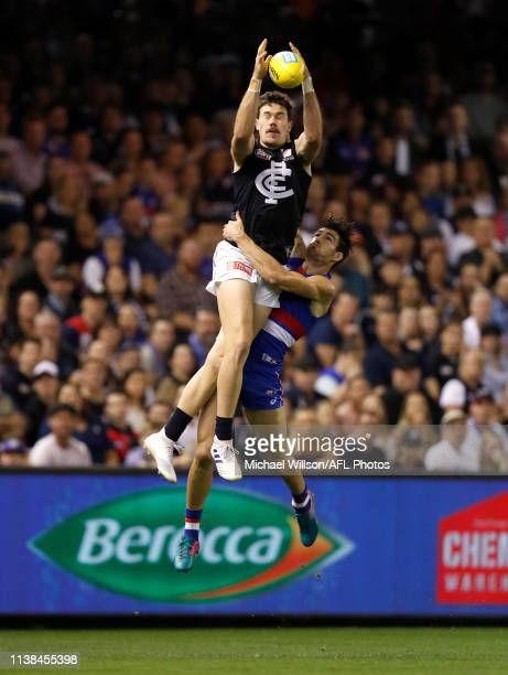 Mitch McGovern of the Blues and Easton Wood of the Bulldogs compete for the ball during the 2019 AFL round 05 match between the Western Bulldogs and...