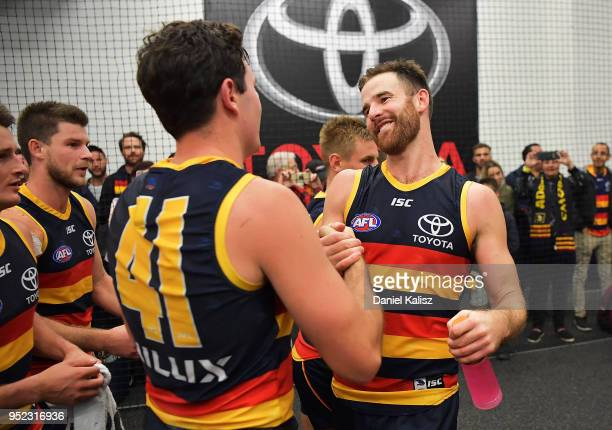 Mitch McGovern of the Crows and Andy Otten of the Crows celebrate after the round six AFL match between the Adelaide Crows and Gold Coast Suns at...