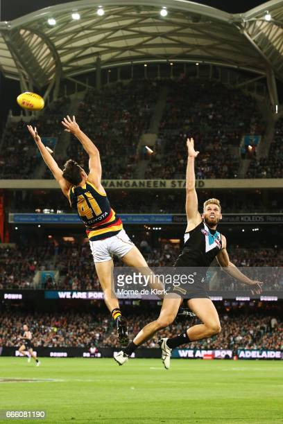 Mitch McGovern of the Crows and Jackson Trengove of the Power compete in the air during the round three AFL match between the Port Adelaide Power and...