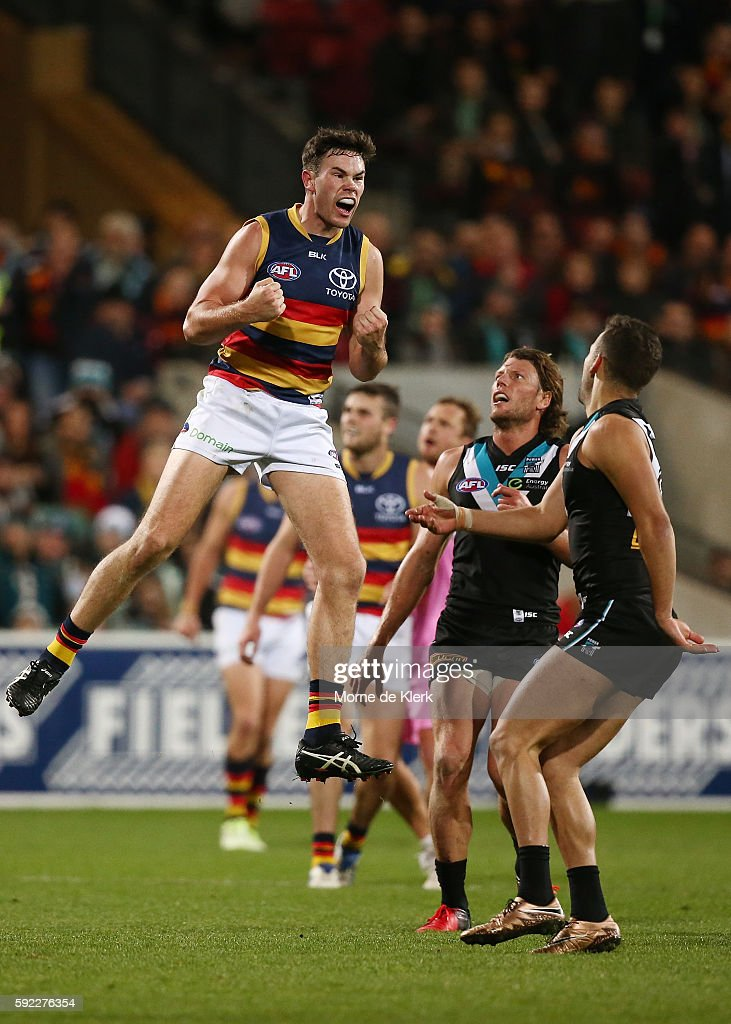 Mitch McGovern of the Crows celebrates after kicking a goal during the round 22 AFL match between the Port Adelaide Power and the Adelaide Crows at Adelaide Oval on August 20, 2016 in Adelaide, Australia.