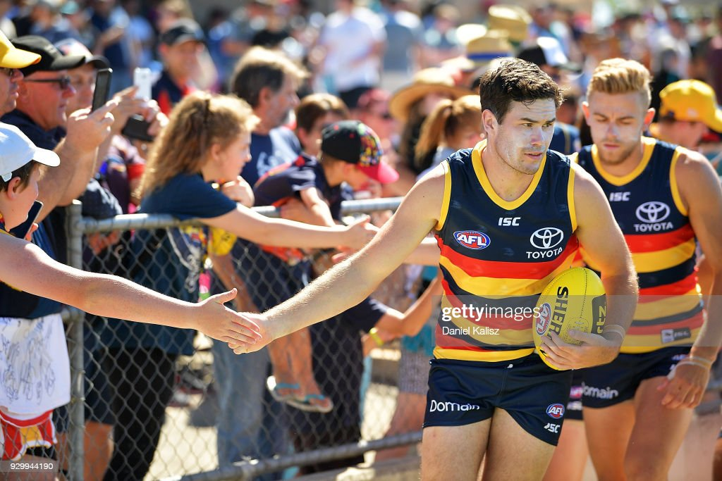 Mitch McGovern of the Crows runs onto the ground priore to the JLT Community Series AFL match between Port Adelaide Power and the Adelaide Crows at Alberton Oval on March 10, 2018 in Adelaide, Australia.