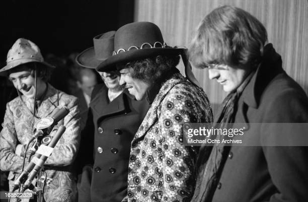 Mitch Mitchell Vic Briggs and Jimi Hendrix pose for photos at a multi band press conference titled 'The British Are Coming' held at The Copter Cub at...