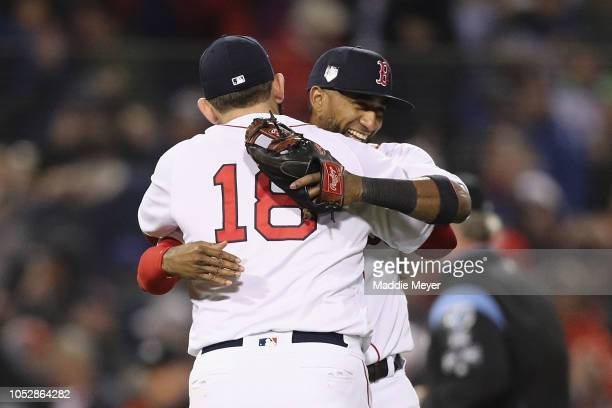 Mitch Moreland and Eduardo Nunez of the Boston Red Sox celebrate their teams 84 win over the Los Angeles Dodgers in Game One of the 2018 World Series...