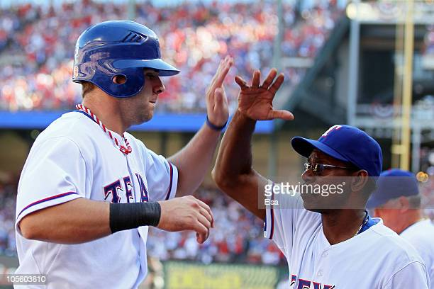 Mitch Moreland celebrates with manager Ron Washington of the Texas Rangers after scoring in the second inning against the New York Yankees in Game...