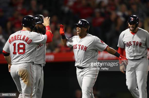 Mitch Moreland Hanley Ramirez and JD Martinez congratulate Rafael Devers of the Boston Red Sox after his grand slam during the third inning of a game...