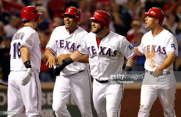 Mitch Moreland Nelson Cruz Mike Napoli and David Murphy of the Texas Rangers celebrate after a Napoli threerun home run in the sixth inning during...
