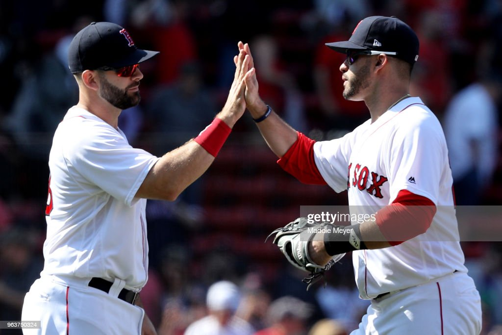 Mitch Moreland #18 of the Boston Red Sox and J.D. Martinez #28 celebrate after the Red Sox defeat the Toronto Blue Jays 6-4 at Fenway Park on May 30, 2018 in Boston, Massachusetts.