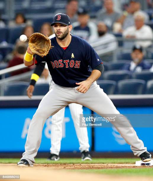 Mitch Moreland of the Boston Red Sox catches a throw to first base in an MLB baseball game against the New York Yankees on September 1 2017 at Yankee...