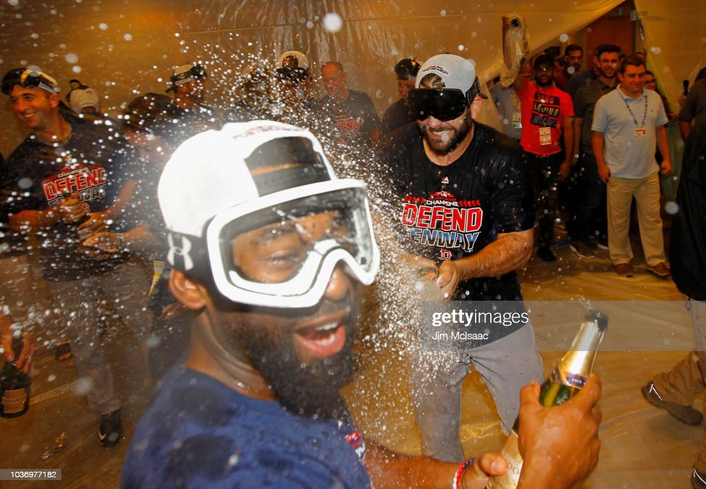 Mitch Moreland #18 (R) of the Boston Red Sox celebrates with teammate Jackie Bradley Jr. #19 in the locker roon after defeating the New York Yankees to clinch the American League East Division at Yankee Stadium on September 20, 2018 in the Bronx borough of New York City.
