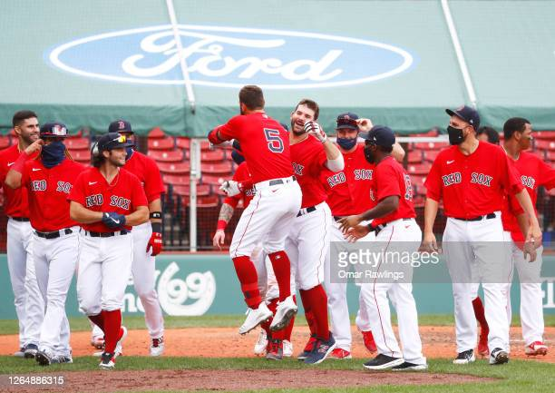 Mitch Moreland of the Boston Red Sox celebrates with the team after hitting a game winning home run in the bottom of the ninth inning against the...