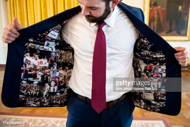 Mitch Moreland of the Boston Red Sox displays his jacket as he takes a tour during a visit to the White House in recognition of the 2018 World Series...