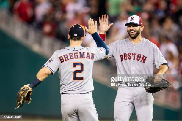 Mitch Moreland of the Boston Red Sox high fives Alex Bregman of the Houston Astros after the 89th MLB AllStar Game at Nationals Park Tuesday July 17...