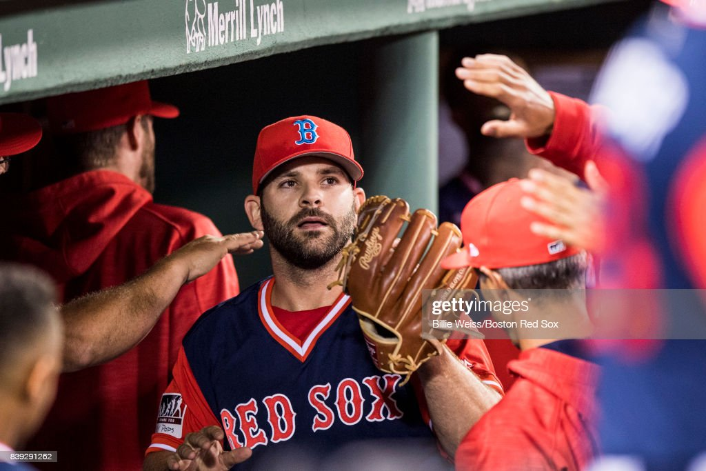 Mitch Moreland #18 of the Boston Red Sox high fives teammates after pitching during the ninth inning of a game against the Baltimore Orioles on August 25, 2017 at Fenway Park in Boston, Massachusetts.