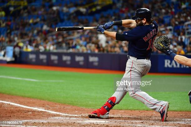 Mitch Moreland of the Boston Red Sox hits a 2run homer off of Emilio Pagan of the Tampa Bay Rays in the ninth inning of a baseball game at Tropicana...