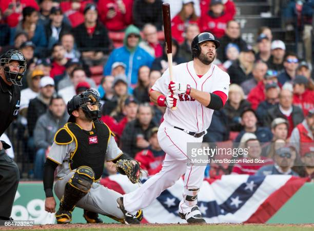 Mitch Moreland of the Boston Red Sox hits a fly ball against the Pittsburgh Pirates in the eighth inning at Fenway Park on April 3 2017 in Boston...