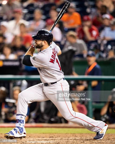 Mitch Moreland of the Boston Red Sox hits a single during the tenth inning of the 89th MLB AllStar Game at Nationals Park Tuesday July 17 2018 in...