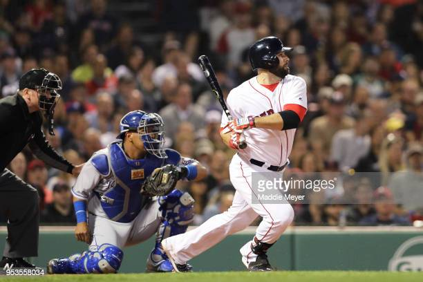 Mitch Moreland of the Boston Red Sox hits a single during the third inning against the Kansas City Royals at Fenway Park on May 1 2018 in Boston...