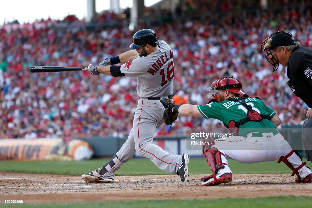 Mitch Moreland #18 of the Boston Red Sox hits a three-run home run during the sixth inning of the game against the Cincinnati Reds at Great American Ball Park on September 23, 2017 in Cincinnati, Ohio. Boston defeated Cincinnati 5-0.