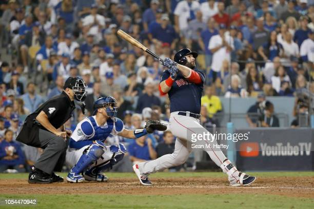 Mitch Moreland of the Boston Red Sox hits a threerun home run in the seventh inning against pitcher Ryan Madson of the Los Angeles Dodgers in Game...