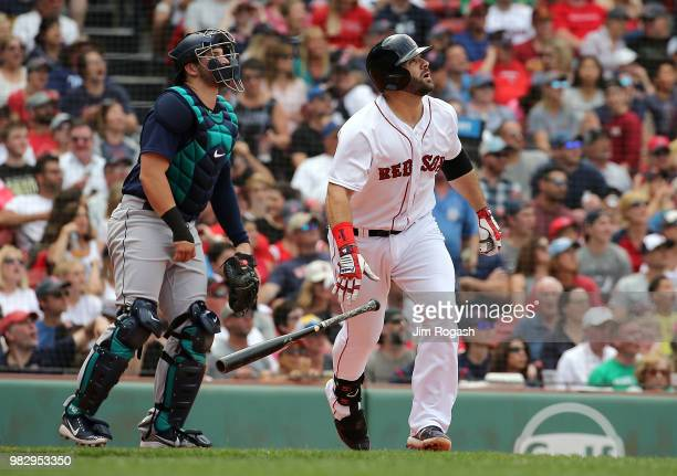 Mitch Moreland of the Boston Red Sox hits a tworun home run against the Seattle Mariners in the sixth inning at Fenway Park on June 24 2018 in Boston...