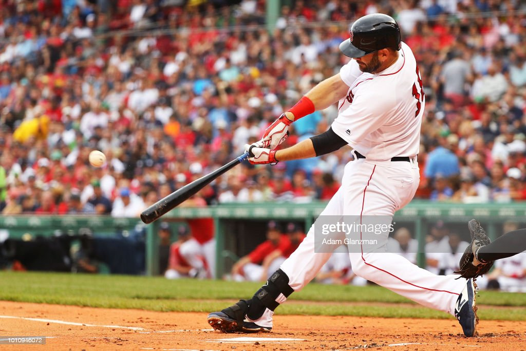 Mitch Moreland #18 of the Boston Red Sox hits a two-run home run in the first inning of a game against the New York Yankees at Fenway Park on August 4, 2018 in Boston, Massachusetts.