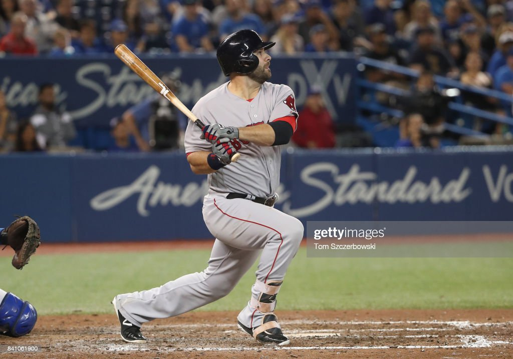 Mitch Moreland #18 of the Boston Red Sox hits a two-run single in the eighth inning during MLB game action against the Toronto Blue Jays at Rogers Centre on August 30, 2017 in Toronto, Canada.