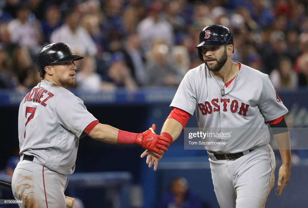 Mitch Moreland #18 of the Boston Red Sox is congratulated by Christian Vazquez #7 after scoring a run in the fifth inning during MLB game action against the Toronto Blue Jays at Rogers Centre on April 18, 2017 in Toronto, Canada.