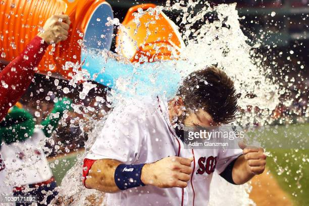 Mitch Moreland of the Boston Red Sox is doused in gatorade following his walkoff hit to win the game in the ninth inning after a victory over the...