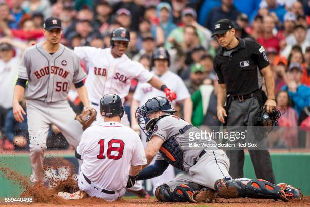 Mitch Moreland of the Boston Red Sox is tagged out by Brian McCann of the Houston Astros during the third inning of game four of the American League...