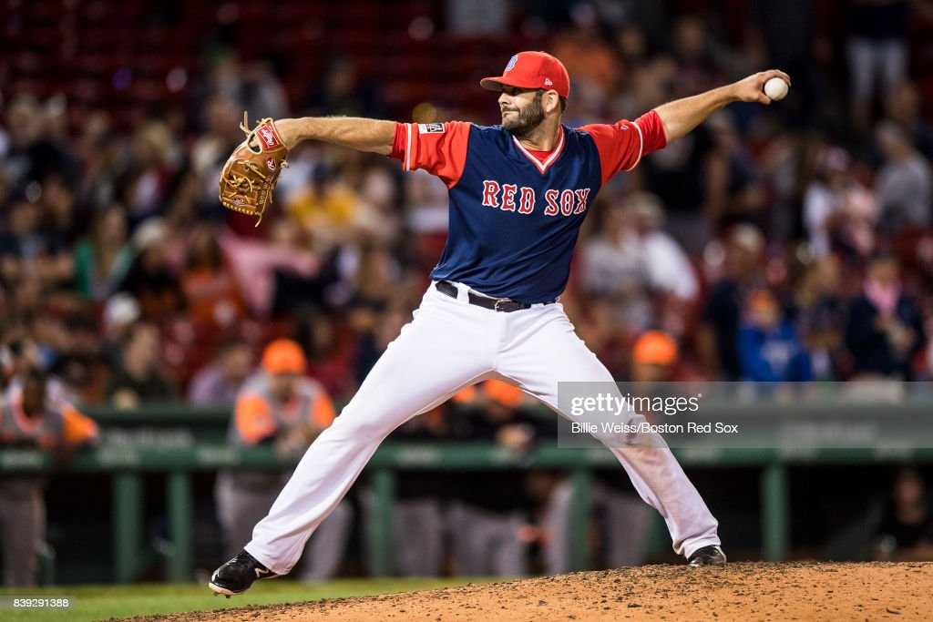 Mitch Moreland #18 of the Boston Red Sox pitches during the ninth inning of a game against the Baltimore Orioles on August 25, 2017 at Fenway Park in Boston, Massachusetts.