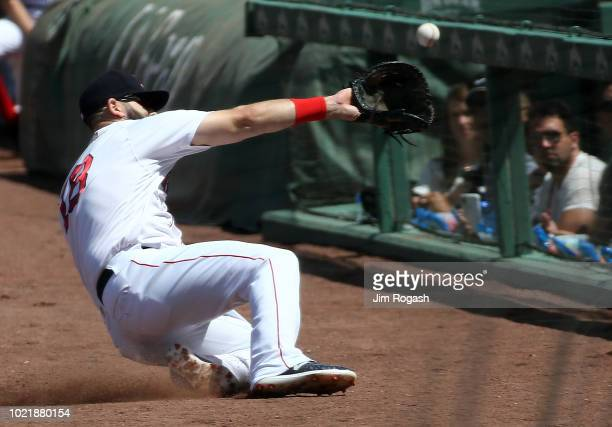 Mitch Moreland of the Boston Red Sox reaches for a foul ball hit by Yandy Diaz of the Cleveland Indians in the first inning at Fenway Park on August...