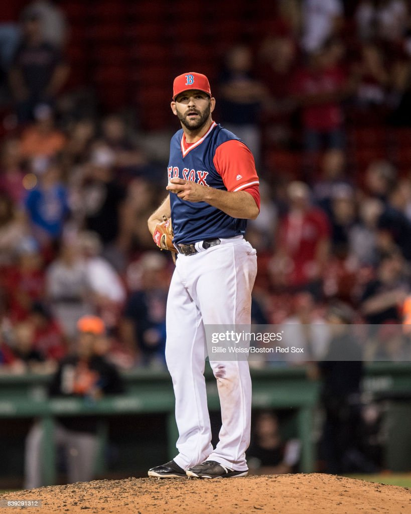 Mitch Moreland #18 of the Boston Red Sox reacts while pitching during the ninth inning of a game against the Baltimore Orioles on August 25, 2017 at Fenway Park in Boston, Massachusetts.