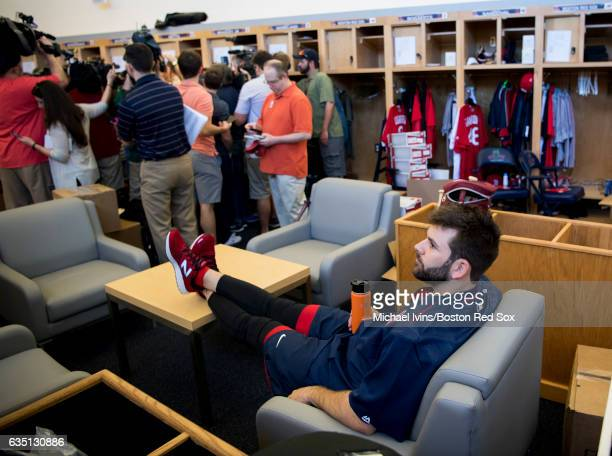 Mitch Moreland of the Boston Red Sox relaxes in the clubhouse while members of the media interview Mookie Betts on February 13 2017 at jetBlue Park...