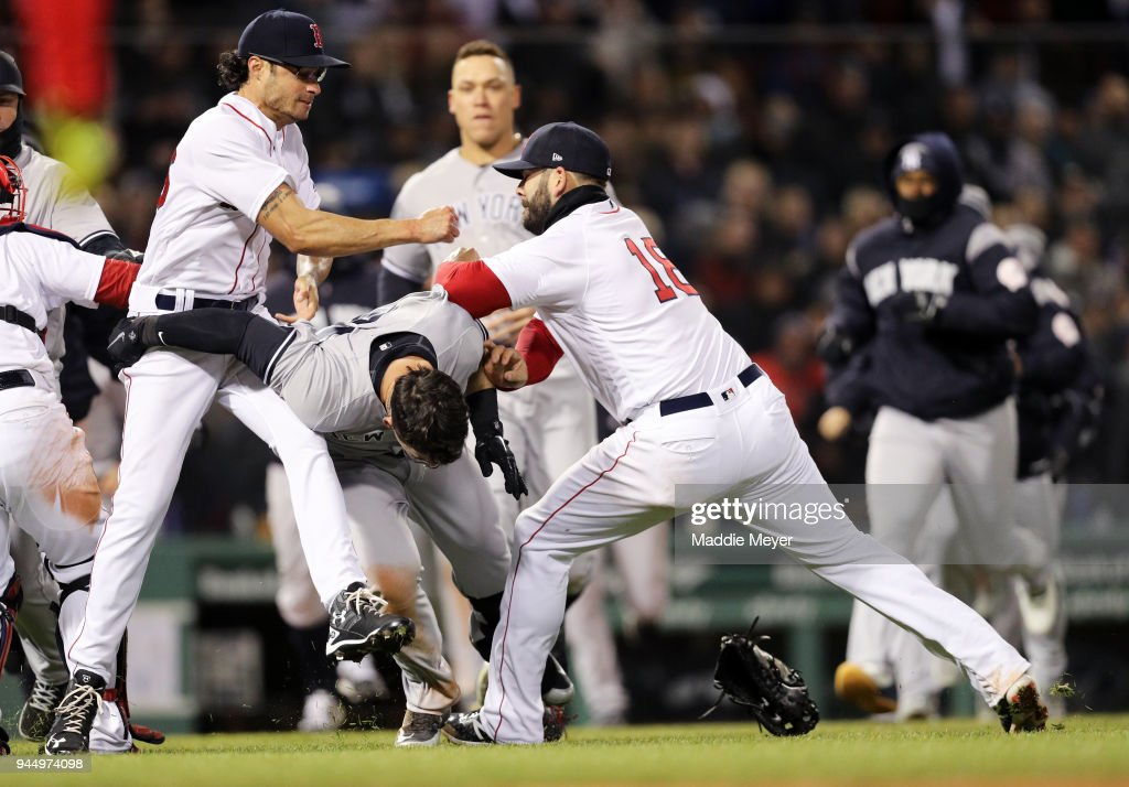 Mitch Moreland #18 of the Boston Red Sox, right, works to separate Joe Kelly #56 and Tyler Austin #26 of the New York Yankees during the seventh inning at Fenway Park on April 11, 2018 in Boston, Massachusetts. Austin rushed the mound after being struck by a pitch from Kelly.