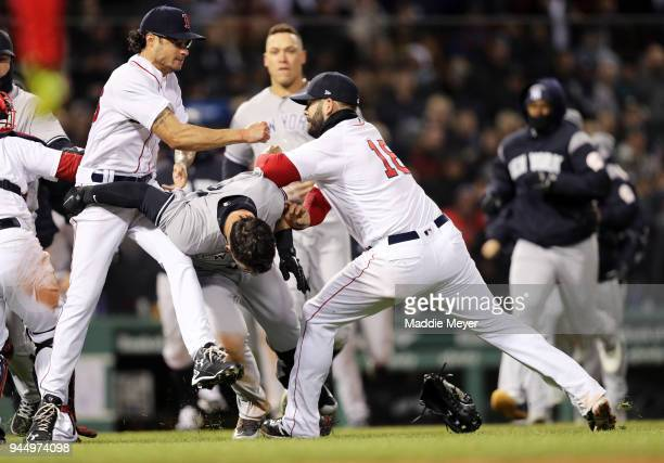 Mitch Moreland of the Boston Red Sox right works to separate Joe Kelly and Tyler Austin of the New York Yankees during the seventh inning at Fenway...