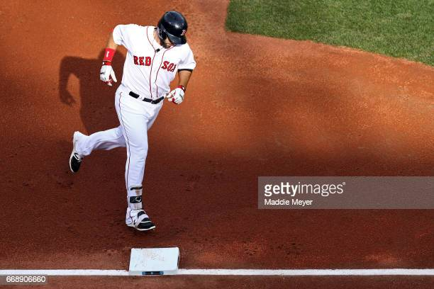 Mitch Moreland of the Boston Red Sox rounds third base after hitting a home run against the Tampa Bay Rays during the second inning at Fenway Park on...