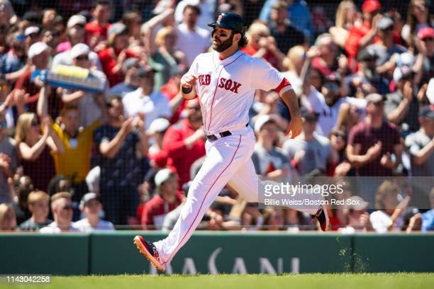 Mitch Moreland of the Boston Red Sox scores during the third inning of a game against the Seattle Mariners on May 11 2019 at Fenway Park in Boston...