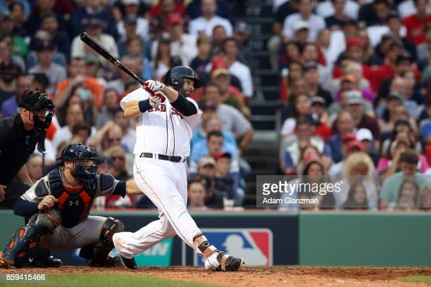 Mitch Moreland of the Boston Red Sox singles in the seventh inning during Game 3 of the American League Division Series against the Houston Astros at...