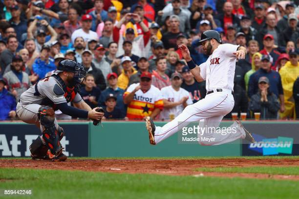 Mitch Moreland of the Boston Red Sox slides into home plate before being tagged out by Brian McCann of the Houston Astros to end the third inning...